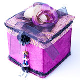 Purple gift box with a rose isolated. Royalty Free Stock Photo