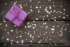 Purple Gift With Ribbon With Snowflakes Royalty Free Stock Images