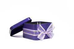Purple gift steel box with bow open cap on white background. Stock Photography