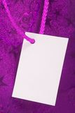 Purple gift tag Royalty Free Stock Image