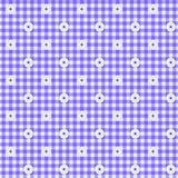 Purple Gingham Fabric Background. A light purple gingham fabric with flowers background that is seamless Royalty Free Stock Photo