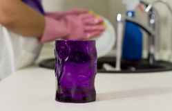 Purple glass on a kitchen counter Stock Image