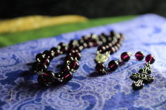 Purple Glass Rosary Stock Image