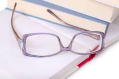 Purple glasses on books Royalty Free Stock Photo