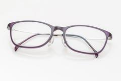 Purple glasses on white background Stock Image