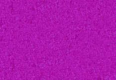 Purple glitter background or wallpaper. A sparkly purple glittter background or wallpaper royalty free stock image