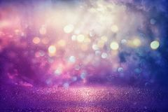 Purple glitter lights background. defocused.