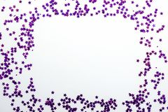 Purple glitter stars white background with copy space Stock Photography