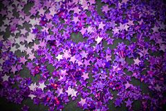 Purple glitter stars white background with copy space Royalty Free Stock Photos