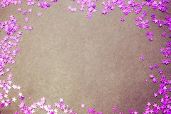 Purple glitter stars white background with copy space Stock Image