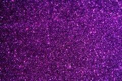 Purple glittering background. Blurred purple glittering and shining background Stock Images