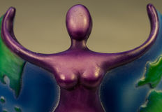 Purple Goddess With Arms Outstretched Stock Photos