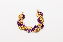 Purple and gold bracelet Royalty Free Stock Images
