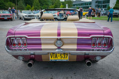 Purple and gold Classic Ford Mustang cabriolet rear view Royalty Free Stock Photo