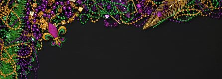 Purple, Gold, and Green Mardi Gras beads and decorations stock photography
