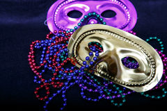 Purple and Gold Masks with Mardi Gras Beads Stock Photography
