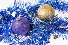Purple and gold ornaments on tinsel decoration background Royalty Free Stock Photography
