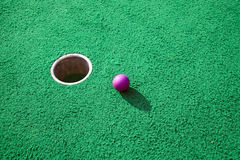 Purple golf ball Royalty Free Stock Image