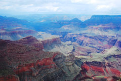 Purple Grand Canyon in the fog. Purple Grand Canyon in the blue fog Royalty Free Stock Photography