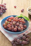 Purple grapes fruit on the plate. Stock Photos