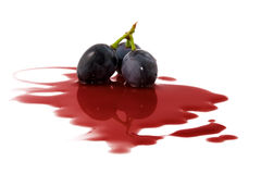 Purple grapes in juice Stock Photography