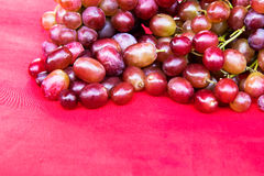 Purple grapes on a red cloth. Stock Photography