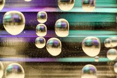 Purple and green bubbles abstract stock images