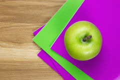 Purple and green exercise-books Stock Photo