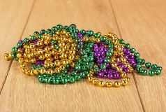Purple, green and gold Mardi Gras beads. Stock Photo