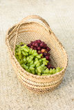 Purple and green grapes. Mature and delicious purple grapes Royalty Free Stock Photography