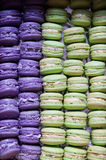 Purple and green macaroon in box Royalty Free Stock Images
