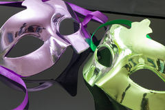 Purple and Green Mask on black background. Purple and Green carnival Mask on black background Stock Photo