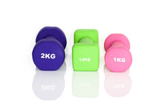 Purple, green and pink fitness dumbbells Stock Images