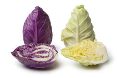 Purple and green pointed mini cabbage. On white background royalty free stock images
