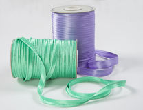 Purple and green ribbon coil Stock Images