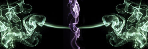 Purple and green smoke background Stock Photography