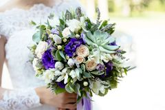 Purple  green succulent  flower wedding bouquet royalty free stock photo