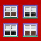 Purple and green windows on red wall. Purple, green and white windows on a red wooden wall. Minimalism style of the houses of Iles de la Magdalen, Canada, in royalty free stock images
