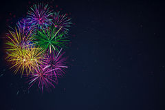 Purple green yellow blue fireworks copy space Royalty Free Stock Photos