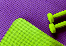 Purple and green yoga mat. dumbbells Royalty Free Stock Photo