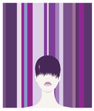 Purple Hair. A young female with 60s style hairstyle in front of striped backdrop Stock Photo