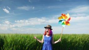 Purple hair girl with pinwheel. At wheat field stock video