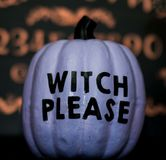 A Purple Halloween Pumpkin Saying Witch Please stock images