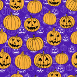 Purple halloween vector print seamless pattern with jack-o-lantern pumpkin. Royalty Free Stock Image