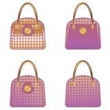 Purple handbags Stock Image