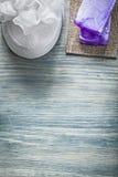 Purple handmade soap white bath sponge on wooden board spa treat royalty free stock images