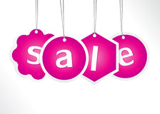 Purple hanging sale labels. Royalty Free Stock Photos