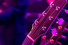 Purple Haze. Closeup of a guitar head in dim purple light Royalty Free Stock Photos