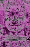 A purple head statue in Bayon Temple in Angor in Cambodia stock photo