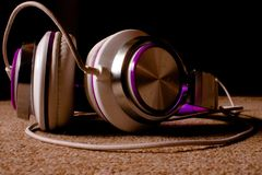 Purple headphone set laying on ground. For background use or wallpaper with text layouts stock images